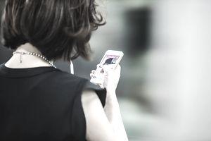 publicist using smartphone