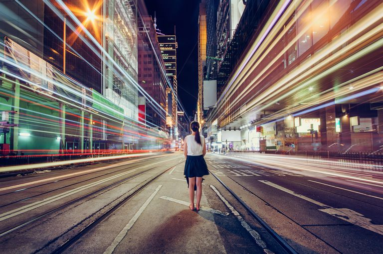 Young woman exploring a metropolitan city at night