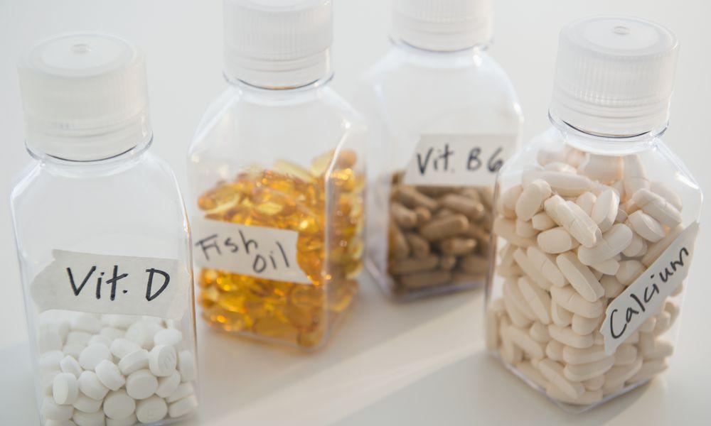 Studio shot of various pills in bottles