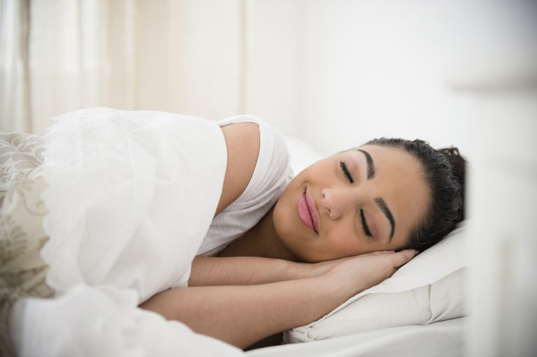 happy woman in bed