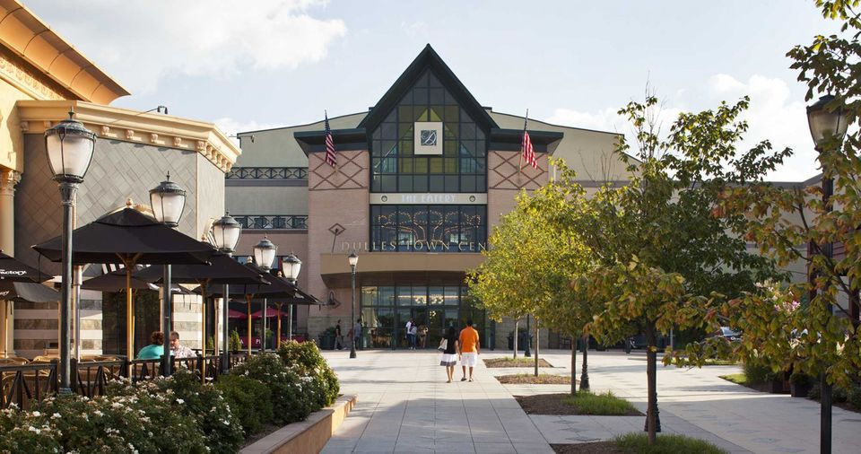 Shoppers walk in the vicinity of Dulles Town Center