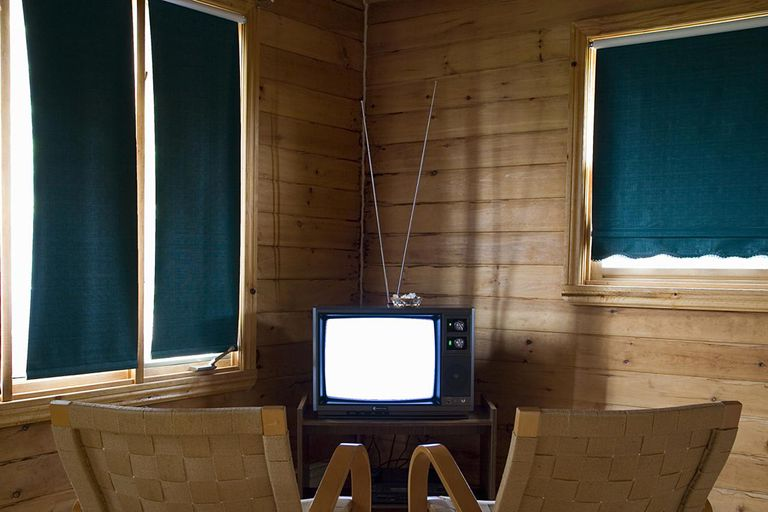 Two chairs in front of television