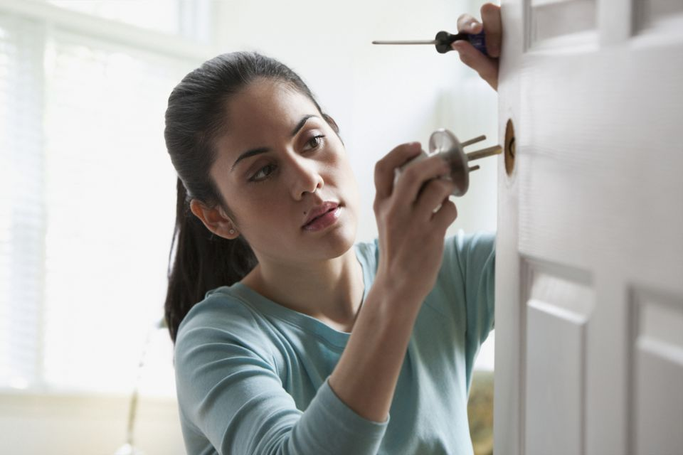 Woman Fixing Door