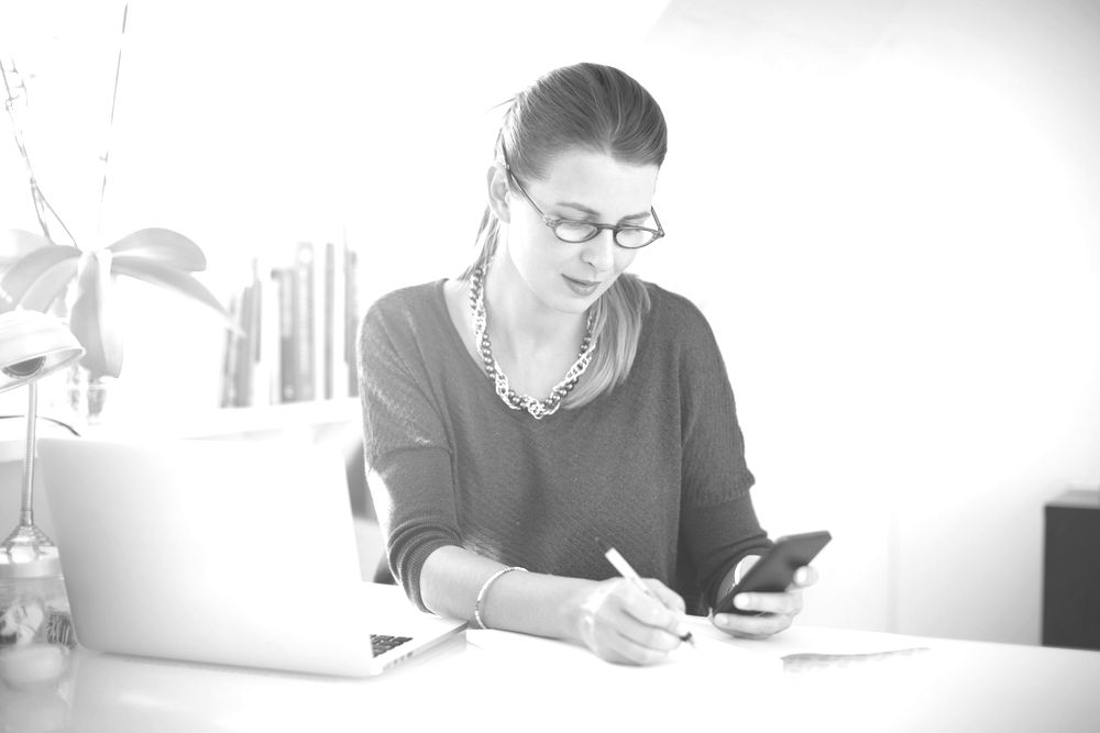 freelance writer at desk setting rates