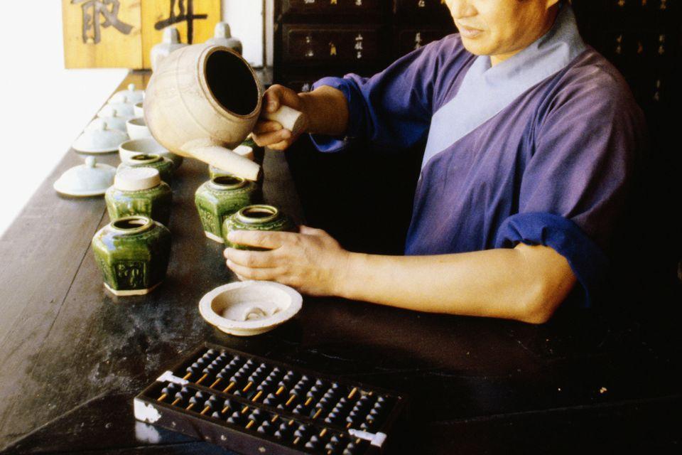 Pouring tea in Hong Kong.