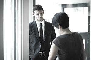 usinessman listening to businesswoman in office