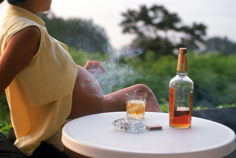 Pregnant woman smoking drinking alcohol cigerette
