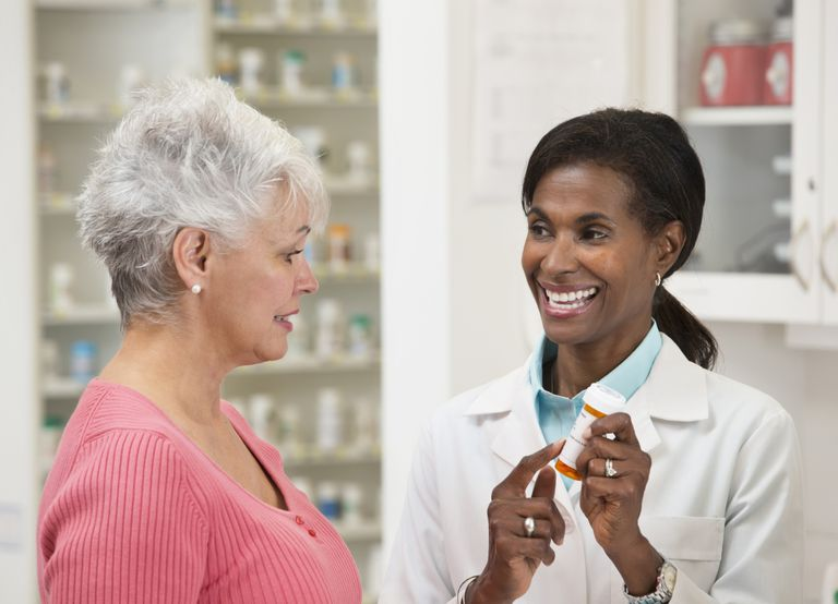Pharmacist giving a woman a prescription of Ativan