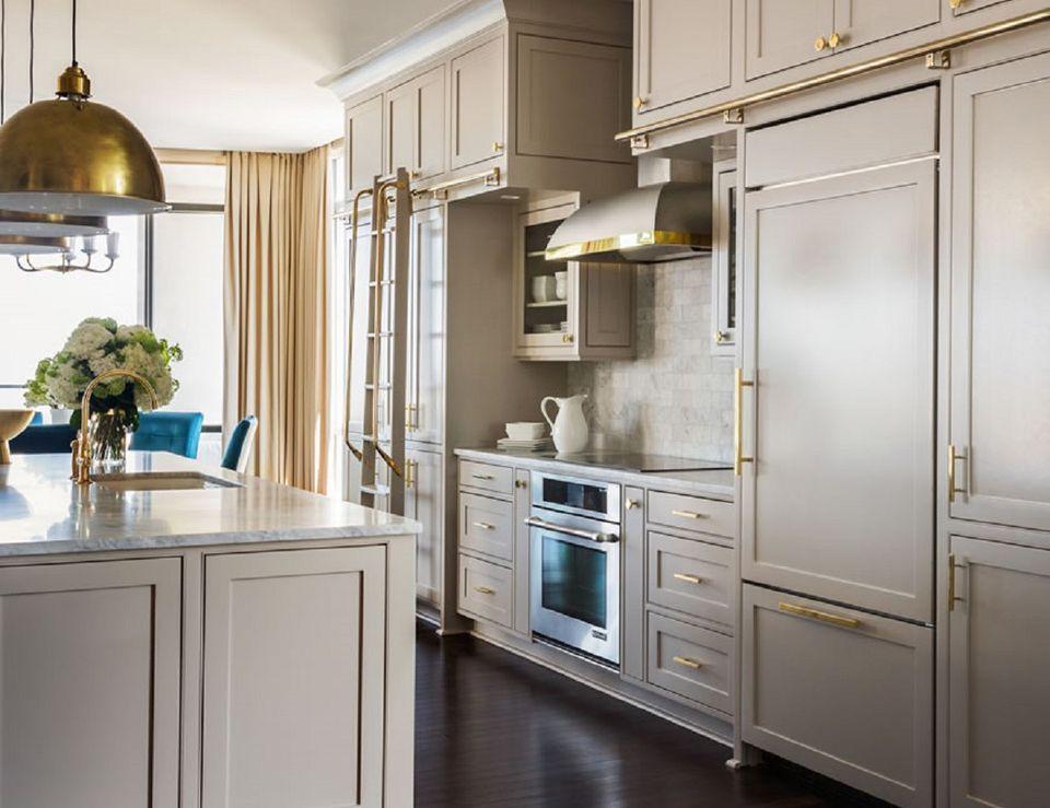 Brass Fixtures, Cream Kitchen Cabinets
