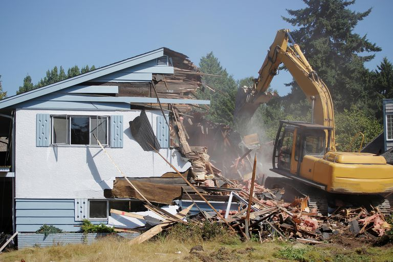 Small Home Being Demolished by Big Machine