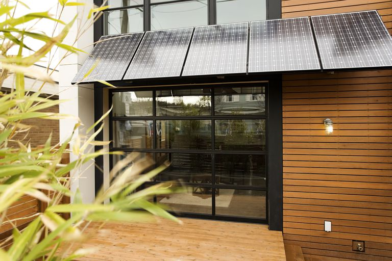 Solar energy, recycled materials, passive heating are all elements of a green house.