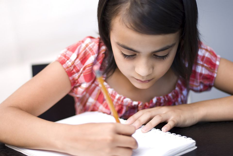 A picture of a girl writing a letter