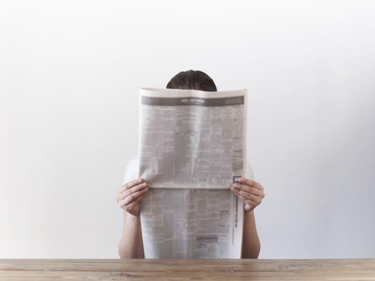Woman looking at newspaper