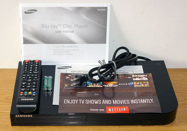 Samsung BD-H5900 Blu-ray Disc Player - Front View with Included Accessories