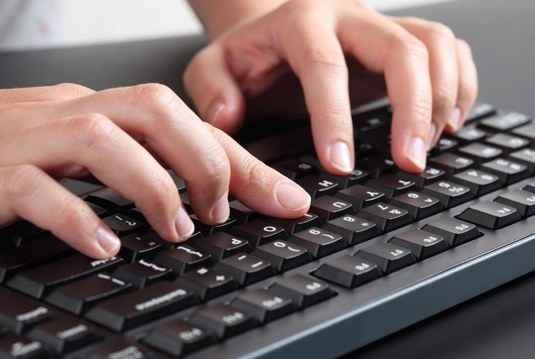 Picture of a woman typing on a keyboard