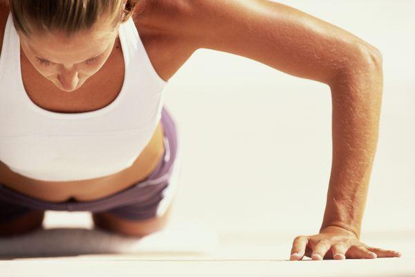 Woman doing pushups on knees