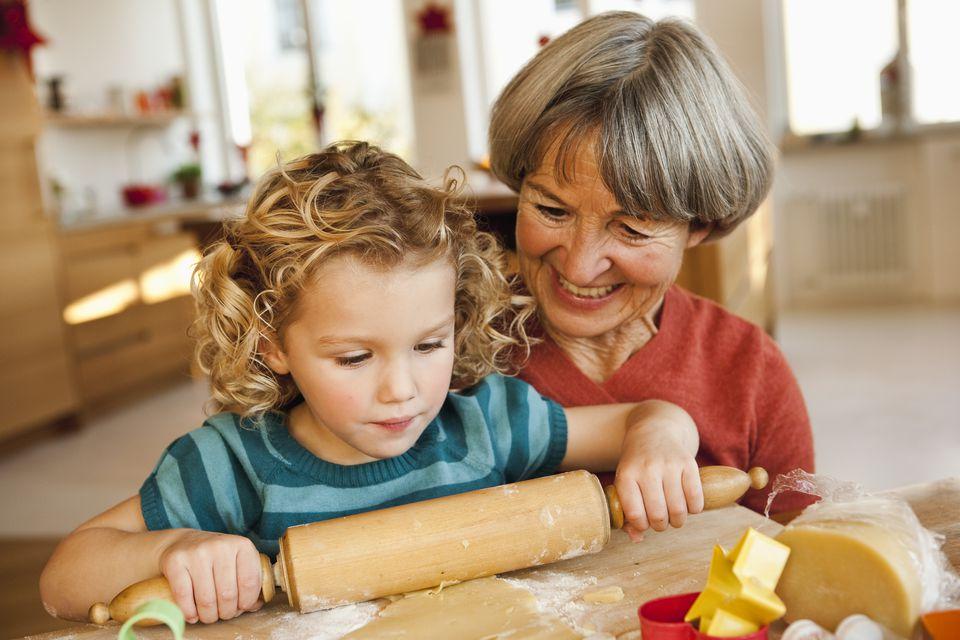 grandchild and grandma rolling dough