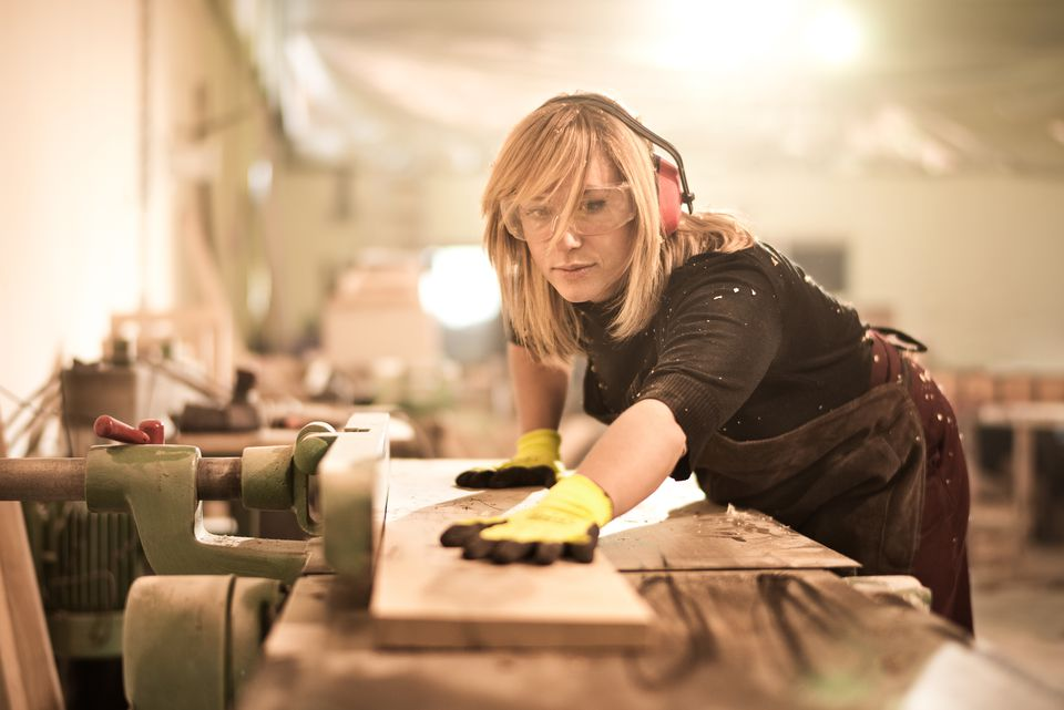 Blonde woman working with plank