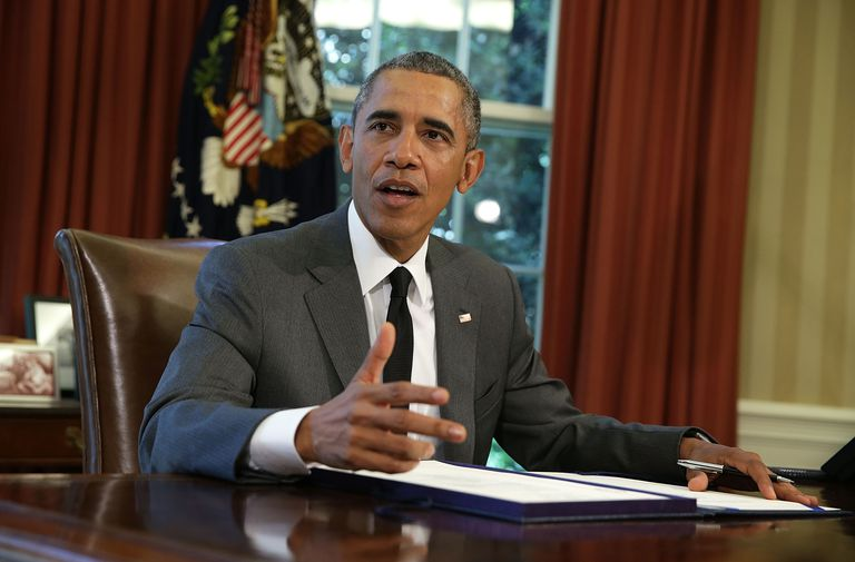 President Obama Signs a Bill in the Oval Office