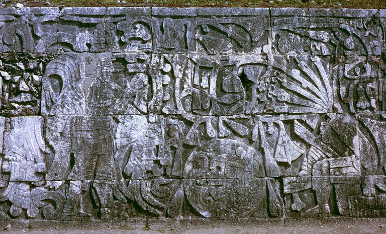 Sculpture in the Great Ballcourt at Chichen Itza depicting sacrifice by decapitation. The figure at left holds the severed head of the figure at right, who spouts blood in the form of serpents from his neck