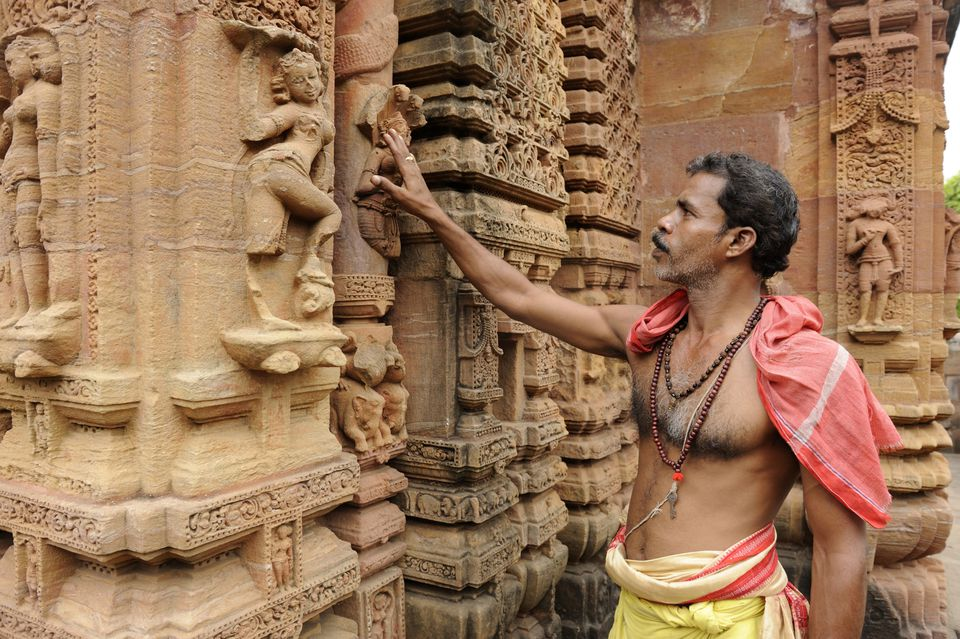 Temple and priest in Bhubaneshwar.