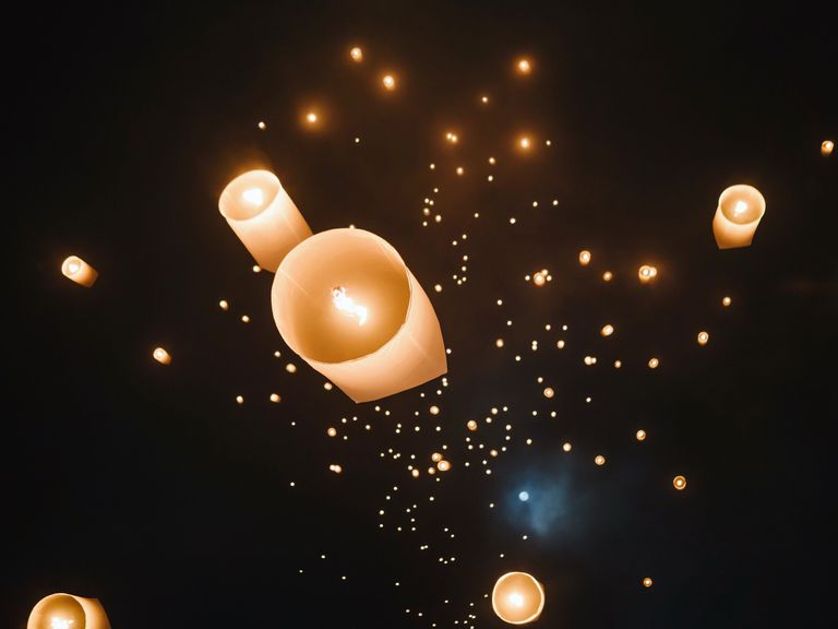 paper lanterns released in the sky