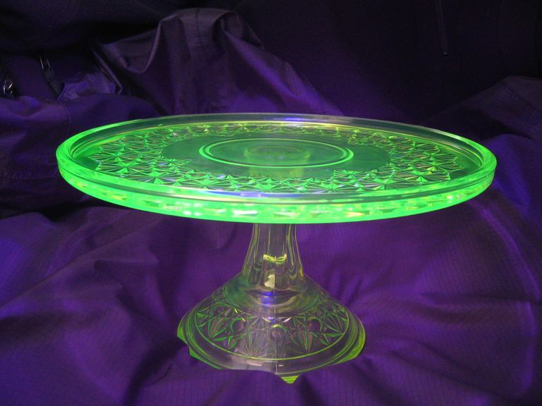 Uranium glass fluoresces brightly under a black or ultraviolet light.