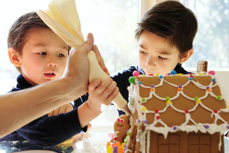 Boys making a gingerbread house