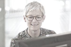 Senior businesswoman working at computer