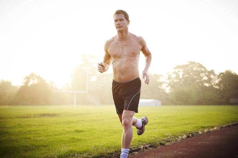 man jogging without a shirt