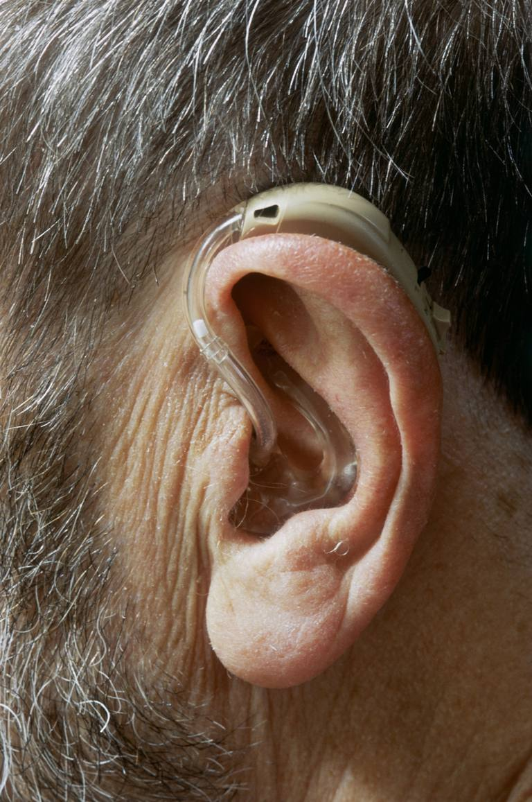 Man with hearing aid fitted in ear