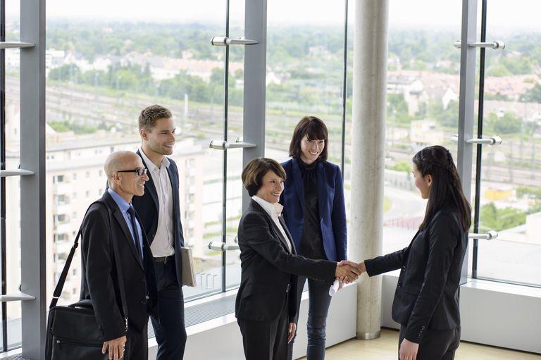 senior female boss with team
