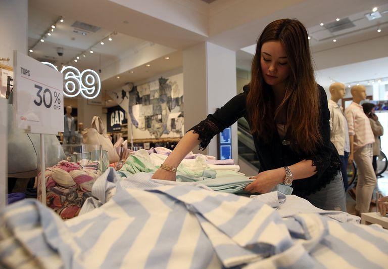 Girl folding in retail store