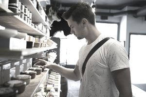 Man shopping for candles in shop