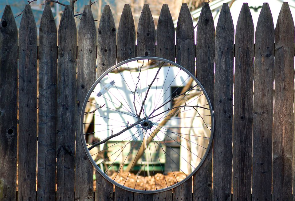 Bike-rim inserts (image) can be used to decorate fences. But not privacy fencing!