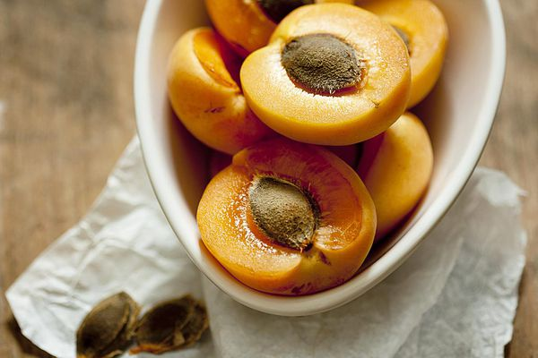 Halved apricots in bowl, close-up