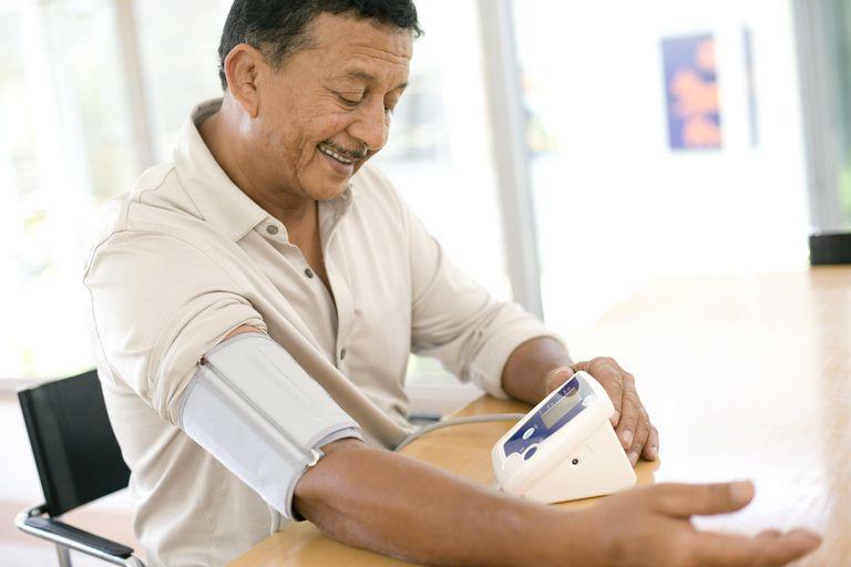 A man checks his blood pressure at home.
