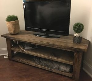 A rustic style corner TV stand.