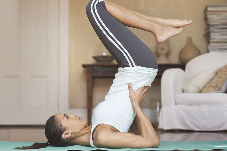 Doing Pilates at home.