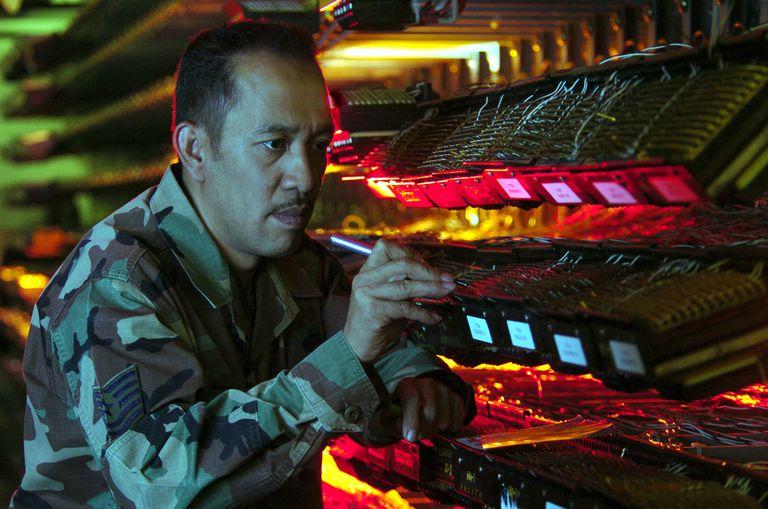 Technician Fixes A Telecommunications Frame