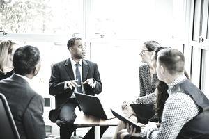Businessman leading team meeting in office