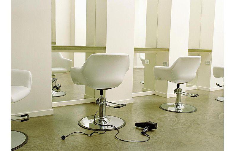Empty hair salon, hair dryer on floor