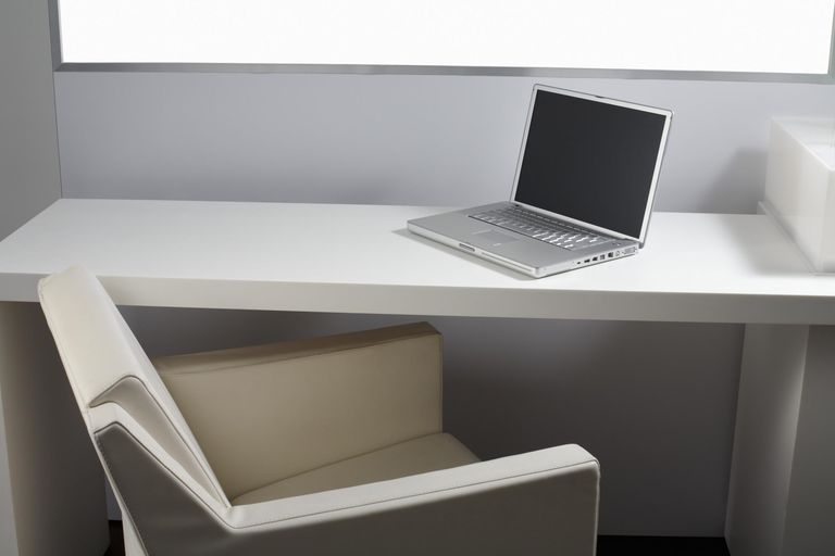 Chair and desk with laptop