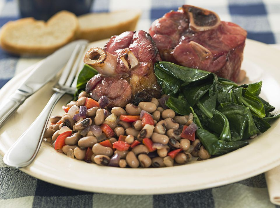 Southern New Year's meal with greens, black-eyed peas, and ham hocks