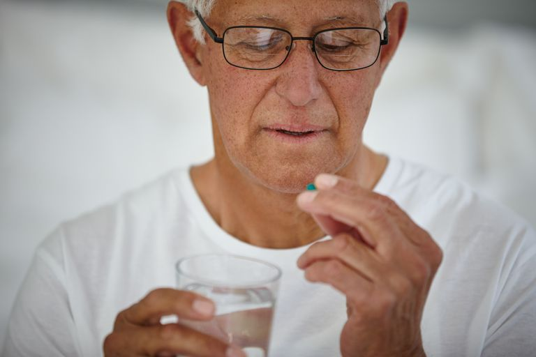 Older Man Taking a Pain Pill