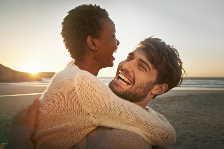 Young couple embracing at the beach