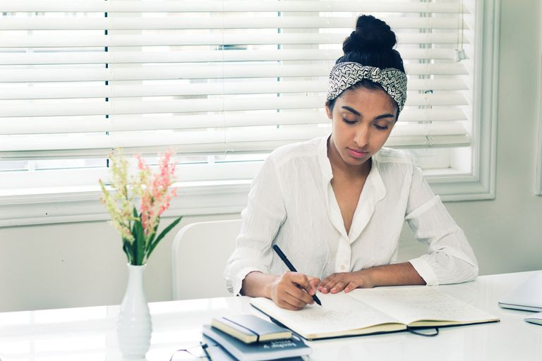 Rupi Kaur working at a desk