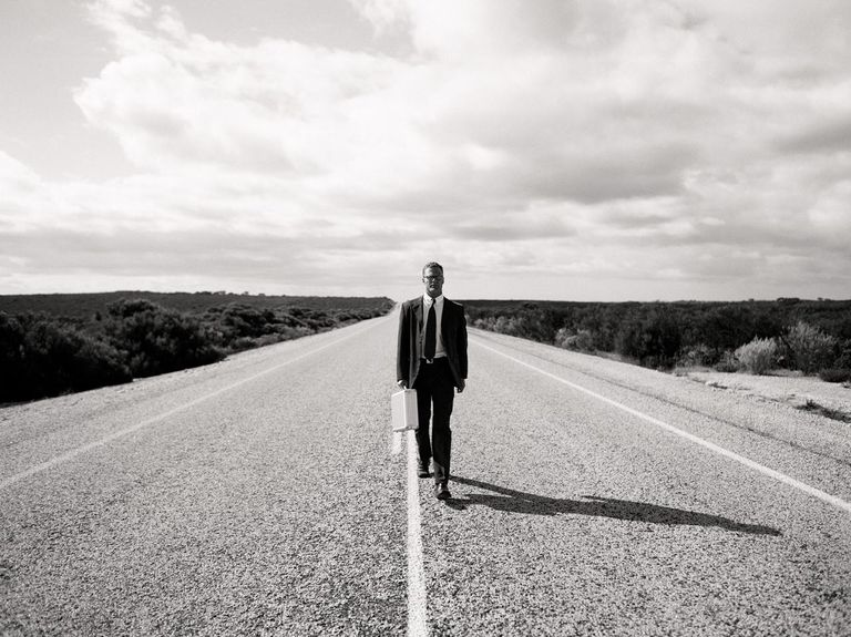 Businessman on a desert highway