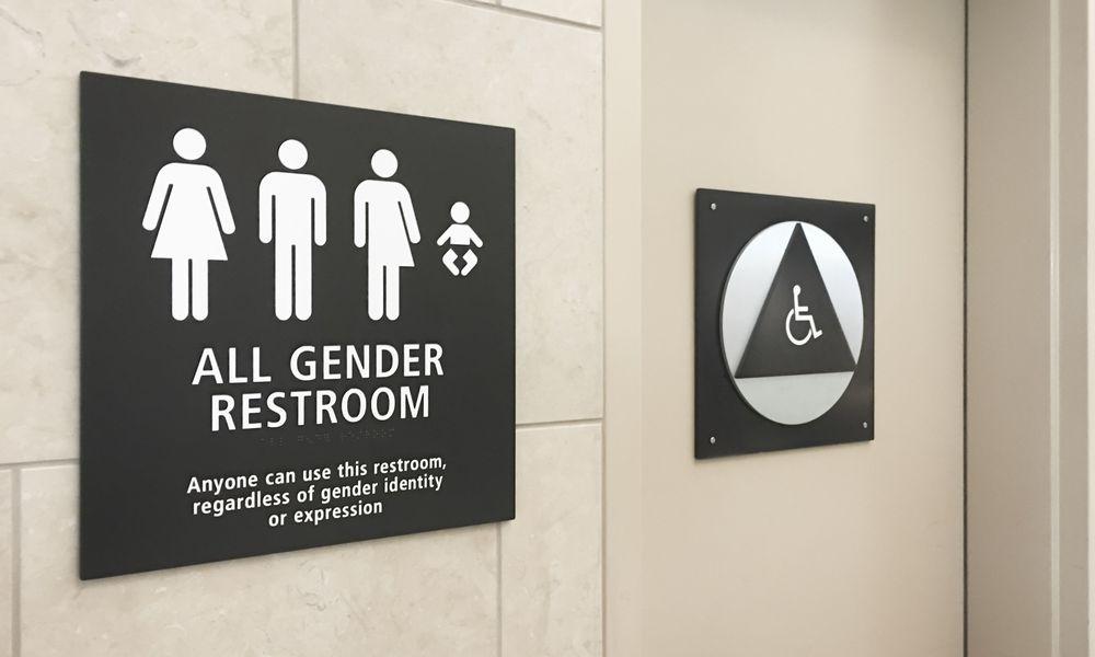 Multi gender bathroom signage in airport