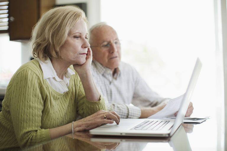 Senior man and woman using computer